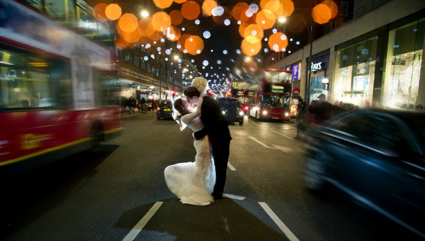 Bride and groom kissing in city traffic by Halo and Hobby at Fabulous Wedding Photography | Confetti.co.uk