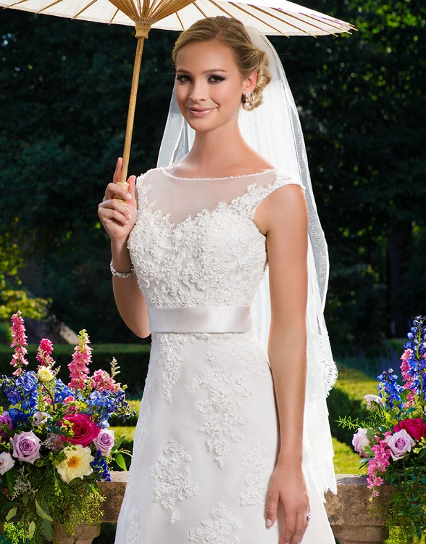 Sincerity Bridal wedding dress on bride with parasol umbrella | Confetti.co.uk