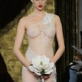Sheer lace wedding dress by Theia Couture | Confetti.co.uk