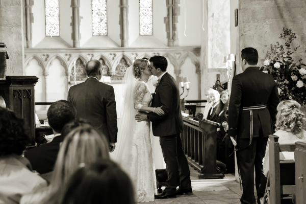 Bride And Groom First Kiss In A Church Wedding Venue | Confetti.co.uk