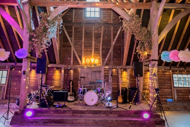 Warble Entertainment band set up in barn | Confetti.co.uk