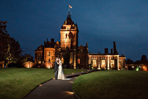 Couple outside Elvetham Hotel at night | Confetti.co.uk