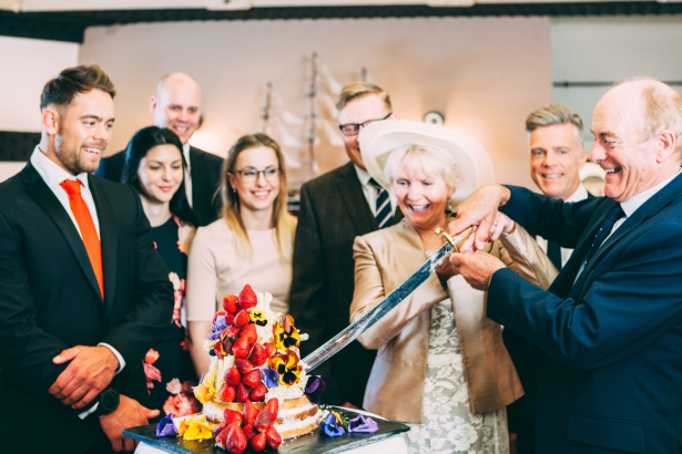 Mature Bride and Groom Slicing the Wedding Cake at a Solent Fort | Confetti.co.uk