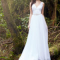 Beautiful bride posing in woodland backdrop in lace and tulle Allure Bridal dress