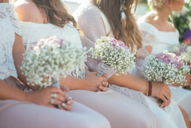 Bridesmaids holding bouquets by Ibiza Flower Shop   Confetti.co.uk