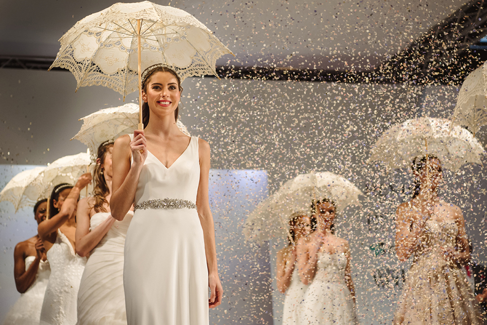 Brides on the Catwalk with parasols and confetti
