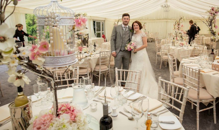 Bride and Groom at their wedding breakfast at Soughton Hall | Confetti.co.uk