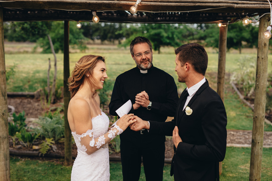 Bride and Groom Exchanging Wedding Vows in Front of Priest - Bride's Speech - Bride's Vows | Confetti.co.uk