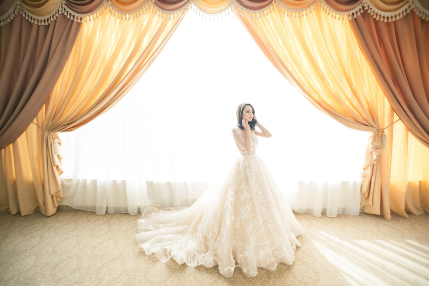Classic Bride Champagne Ballgown Wedding Dress - Advice for Planning the Perfect Honeymoon with Tinggly   Confetti.co.uk