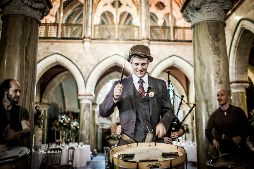 Marble Hall – Taken during the drinks reception - Caledonia Band were playing and gave the groom an opportunity to become an honorary member of the band - by vanishingmomentsphotography