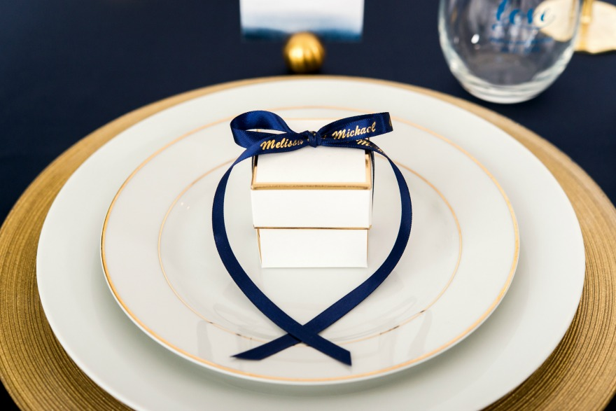 Winter wedding favour box with personalised navy and gold ribbon   Confetti.co.uk