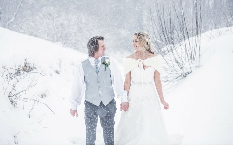 Jemma and Steve pose in snowy weather