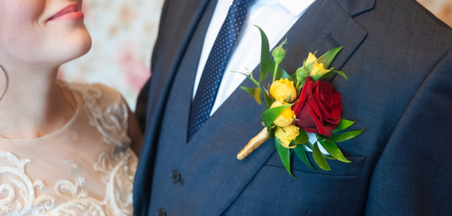 Buttonhole in red and yellow | Confetti.co.uk