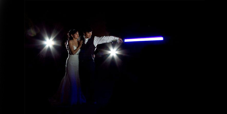 Awesome Star Wars Photo Booth - Michelle Chiu Photography - Bride and Groom Wedding Photoshoot with Lightsabers | Confetti.co.uk