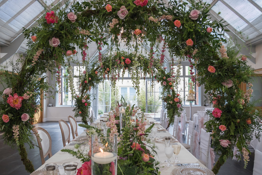 Interesting Wedding Reception Decor - Creative Wedding Decor - Floral Hoops - Floral Arches Over the Wedding Reception Table with Hanging Flowers | Confetti.co.uk