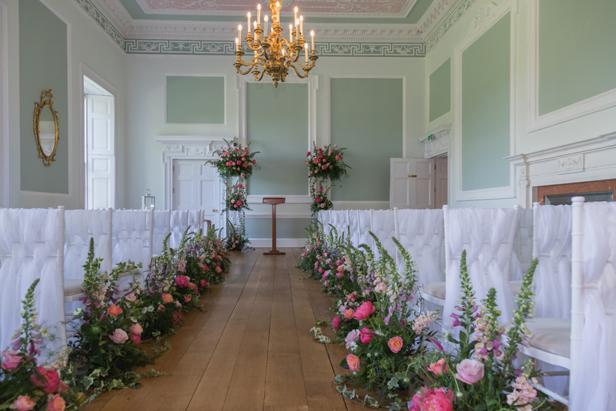 Wedding Ceremonies in a Country House Wedding Venue - Colourful Wedding Aisle Decorations - Summer Wedding Flowers | Confetti.co.uk
