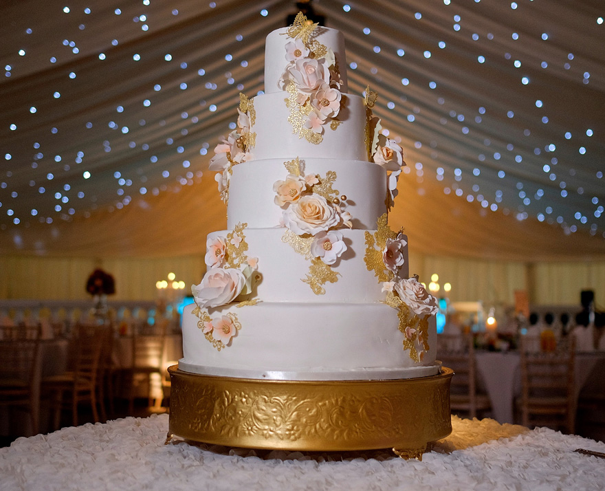 Rose Gold Wedding Cake by Sweet Hollywood - Peach and Metallic Gold Cake - Roses and Butterflies Wedding Cake   Confetti.co.uk