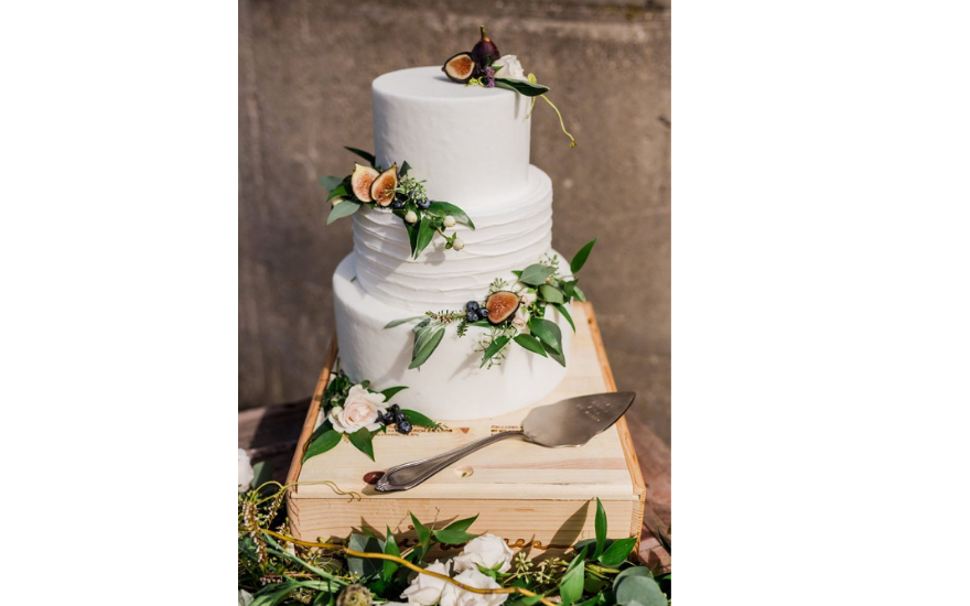 white wedding cake with figs