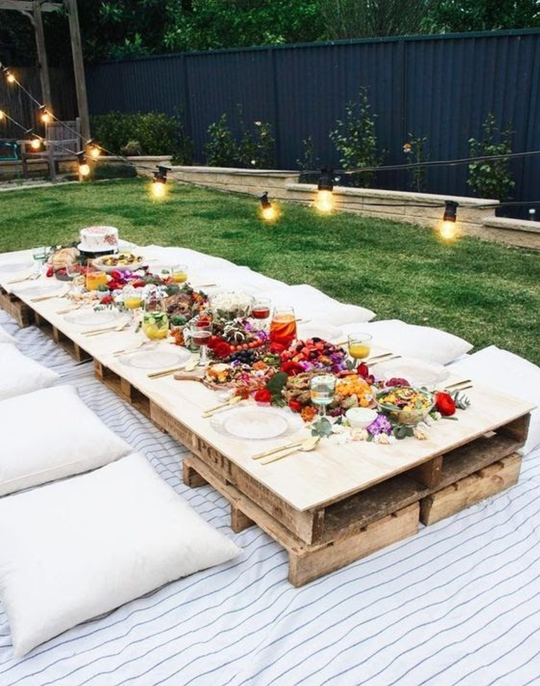 A picture containing table, grass, outdoor, plate  Description automatically generated