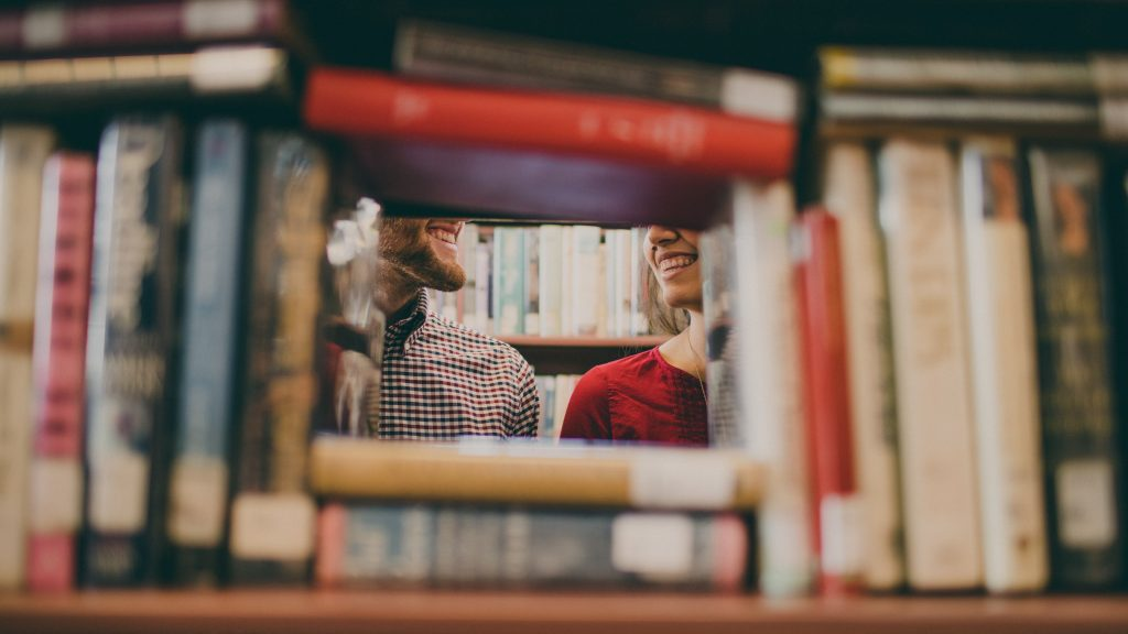 contemporary wedding readings - couple posing with books